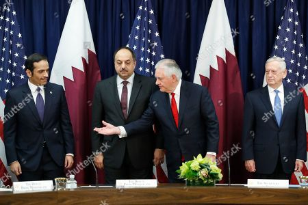 Stock Image of Rex Tillerson, Sheikh Mohammed bin Abdulrahman Al Thani, James Mattis, Khalid bin Mohammed al-Attiyah. Secretary of State Rex Tillerson, second from right, gestures toward ?Qatar's Foreign Minister Sheikh Mohammed bin Abdulrahman Al Thani, far left, as they meet with Qatar's Defense Minister Khalid bin Mohammed al-Attiyah, and and Defense Secretary James Mattis, far right, during the US Qatar Strategic Dialogue ?at the State Department, in Washington