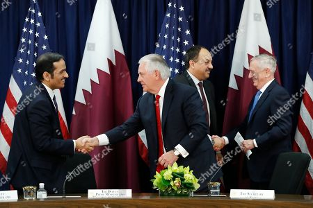 Stock Picture of Rex Tillerson, Sheikh Mohammed bin Abdulrahman Al Thani, James Mattis, Khalid bin Mohammed al-Attiyah. Qatar's Foreign Minister Sheikh Mohammed bin Abdulrahman Al Thani, left, shakes hands with Secretary of State Rex Tillerson, as Qatar's Defense Minister Khalid bin Mohammed al-Attiyah, shakes hands with Defense Secretary James Mattis, right, after signing memorandums of understanding during the US Qatar Strategic Dialogue ?at the State Department, in Washington