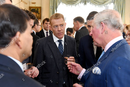LONDON, ENGLAND - JANUARY 30: Prince Charles (R) talks to presenter Adam Henson (C) as he hosts a Crop Trust reception
