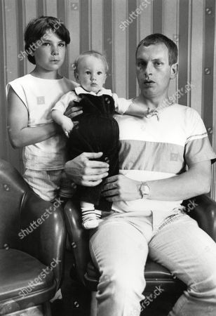 Marie Wilks Murder: Husband Adrian Wilks with his baby son Mark and the kid-sister of his wife Georgina Gough. June 1988
