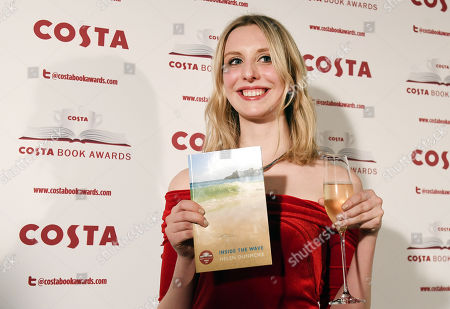 Stock Photo of Tess Charnley, daughter of Helen Dunmore, poses for pictures after accepting the Winner of the Costa Book Awards 2018 prize for her mother's book of poems 'Inside The Wave' at the Costa Book Awards in London, Britain, 30 January 2018.