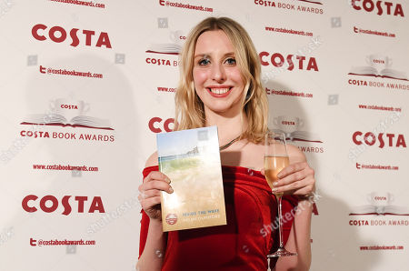 Tess Charnley, daughter of Helen Dunmore, poses for pictures after accepting the Winner of the Costa Book Awards 2018 prize for her mother's book of poems 'Inside The Wave' at the Costa Book Awards in London, Britain, 30 January 2018.