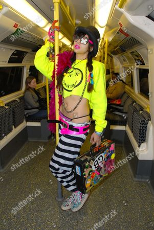 Stock Picture of Namalee Bolle editor of Super Super Magazine wearing New Rave styles on the underground London December 2006