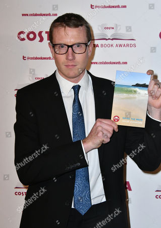 Patrick Charnley with his mother's Helen Dunmore book Inside the Wave