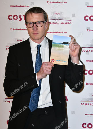 Stock Image of Patrick Charnley with his mother's Helen Dunmore book Inside the Wave