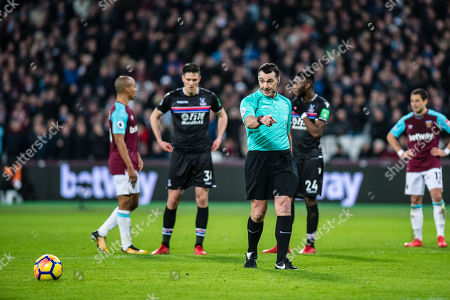 Referee Neil Swarbrick show for penalty spot during the Premier League match between West Ham United and Crystal Palace at the London Stadium, London