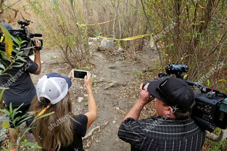 """Stock Image of Journalists view the spot where Mark Salling, who played Noah """"Puck"""" Puckerman in the hit musical-comedy """"Glee,"""" was found dead in a remote area of Big Tujunga Canyon in the Sunland-Tujunga area of Los Angeles, . Authorities say Salling died of an apparent suicide. He was 35"""