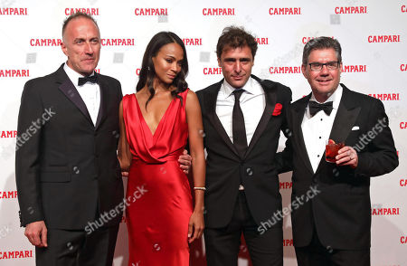 (L-R) Italian director Stefano Sollima, US actress Zoe Saldana, Italian actor Adriano Giannini, and Campari Group CEO Bob Kunze-Concewitz poses for photographers on the red carpet for premiere of the short movie 'Campari Red Diaries - The Legend of Red Hand' in Milan, Italy, 30 January 2018. Camapri Group launched the film as part of their new advertising campaign.
