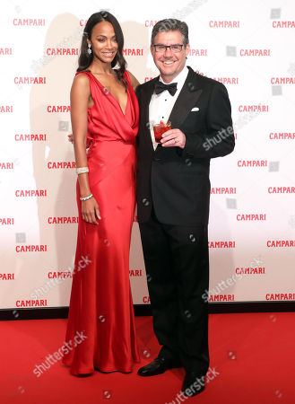 US actress Zoe Saldana (L) and Campari Group CEO Bob Kunze-Concewitz (R) pose for photographers on the red carpet for premiere of the short movie 'Campari Red Diaries - The Legend of Red Hand' in Milan, Italy, 30 January 2018. Camapri Group launched the film as part of their new advertising campaign.