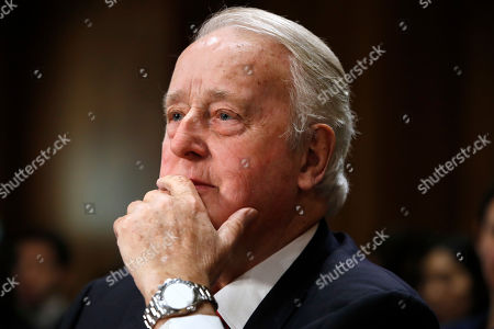 Brian Mulroney, the former prime minister of Canada, right, listens during a Senate Foreign Relations Committee hearing on the Canada-U.S.-Mexico relationship, on Capitol Hill in Washington
