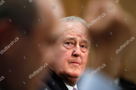 Brian Mulroney, the former prime minister of Canada, listens as Jaime Serra Puche, Mexico's former secretary of commerce and industry, speaks at a Senate Foreign Relations Committee hearing on the Canada-U.S.-Mexico relationship, on Capitol Hill in Washington
