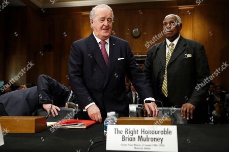 Brian Mulroney, the former prime minister of Canada, left, takes his seat for a Senate Foreign Relations Committee hearing on the Canada-U.S.-Mexico relationship, on Capitol Hill in Washington