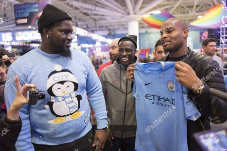 France and Manchester City Left Back Benjamin Mendy with Menelik Watson the  English professional American football offensive tackle for the Denver Broncos and  Former New York Giants player now BBC NFL Commentator Osi Umenyiora