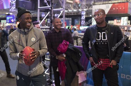 France and Manchester City Left Back Benjamin Mendy with Menelik Watson and  Former New York Giants player now BBC NFL Commentator Osi Umenyiora