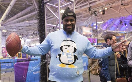 Menelik Watson the  English professional American football offensive tackle for the Denver Broncos at the NFL Experience