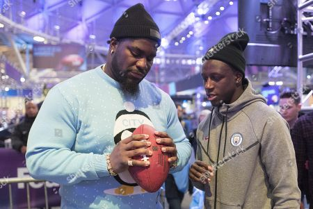 France and Manchester City Left Back Benjamin Mendy with Menelik Watson the  English professional American football offensive tackle for the Denver Broncos at the NfL Experience