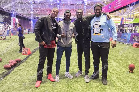 L to r  New York Giant's Osi Umenyiora ,   Manchester City  Left Back  Benjamin Mendy ,Stormzy and Manchester UK  Born Denver Broncos Offensive Tackle Menelik Watson   at NFL Experience in Downtown Minneapolis