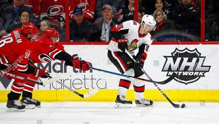 Sebastian Aho, Elias Lindholm, Matt Duchene. Ottawa Senators' Matt Duchene (95) skates away from Carolina Hurricanes' Elias Lindholm (28) and Sebastian Aho (20) during the first period of an NHL hockey game, in Raleigh, N.C