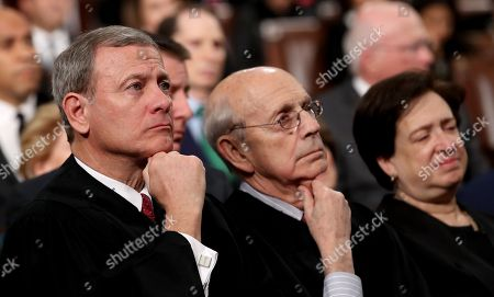 U.S. Supreme Court Chief Justice John G Roberts Jnr (L-R), Associate Justice Stephen G. Breyer, and Associate Justice Elena Kagan listen to President Trump's State of the Union address in the chamber of the U.S. House of Representatives in Washington, DC.