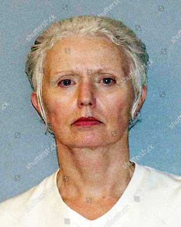 Provided by the U.S. Marshals Service shows Catherine Greig, longtime girlfriend of Whitey Bulger, who was captured with Bulger in 2011 in Santa Monica, Calif. Greig already is serving an eight-year prison term for helping Bulger avoid capture. She is expected to plead guilty in federal court in Boston, to a criminal contempt charge for refusing to testify before a grand jury investigating whether other people helped Bulger during his 16 years on the run
