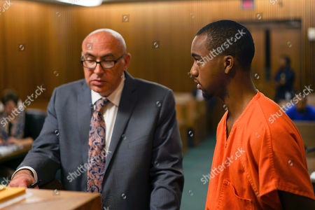 Stock Photo of David Magee, left, a Cuyahoga County public defender, and defendant Hercules Shepherd Jr. attend Shepherd's arraignment in Cleveland. Shepherd's file was scored with risk-assessment software on the first day of the software's use in Cleveland Municipal Court. In a growing number of local and state courts, including Cleveland, judges are now guided by computer algorithms before ruling whether criminal defendants can return to everyday life, or remain locked up awaiting trial
