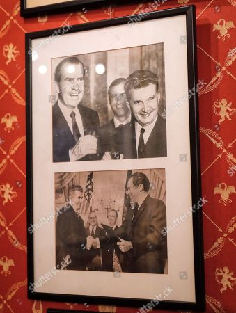 On, photographs of former Romanian dictator Nicolae Ceausescu and U.S. President Richard Nixon, on display at an auction house in Bucharest, Romania. A Romanian auction house is selling memorabilia that belonged to former Communist dictator Nicolae Ceausescu to mark would have been his 100th birthday