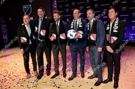 David Beckham, Marcelo Claure, Jorge Mas, Jose Mas, Don Garber, Simon Fuller. David Beckham, third from left, poses for a group photo at an event where it was announced that Major League Soccer is bringing an expansion team to Miami, in Miami. From left to right are Jorge Mas, Marcelo Claure, Beckham, MLS Commissioner Don Garber, Jose Mas, and Simon Fuller