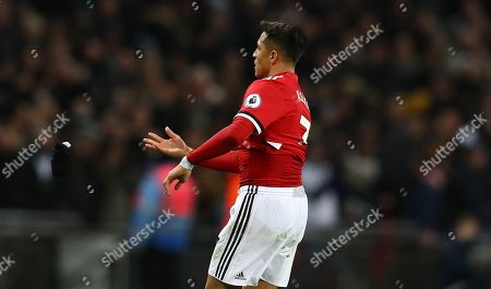 Alexis Sanchez of Manchester United throws away his gloves after Phil Jones scores an own goal