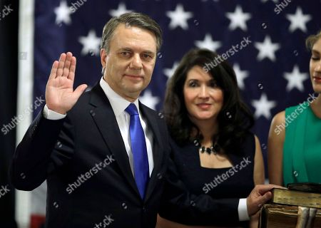 Republican Jeff Colyer is sworn in as the 47th Governor of Kansas during a ceremony at the Statehouse in Topeka, Kan., . Colyer, the state's longest-serving lieutenant governor, replaced former GOP Gov. Sam Brownback immediately after Brownback stepped down to become U.S. ambassador-at-large for international religious freedom