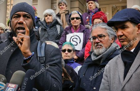 Council members Jumaane Williams, far left, and Ydanis Rodriguez, far right, hold a press conference on behalf of Ravi Ragbir, second from right, a citizen of Trinidad and Tobago and executive director of the New Sanctuary Coalition of New York City, at New York City Hall. Williams and Rodriguez were arrested as they attempted to block authorities from taking Ragbir into custody on Jan. 11 after a routine check-in with immigration officials in New York. A federal judge on Monday ordered authorities to immediately release Ragbir on the grounds he hadn't been given enough time to say goodbye to his family