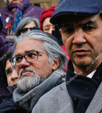 Ravi Ragbir, left, a citizen of Trinidad and Tobago and executive director of the New Sanctuary Coalition of New York City, and Council member Ydanis Rodriguez, right, listen during a press conference as he fights deportation, at New York City Hall. Rodriguez was one of two council members arrested as they attempted to block authorities from taking Ragbir into custody on Jan. 11 after a routine check-in with immigration officials in New York. A federal judge on Monday ordered authorities to immediately release Ragbir on the grounds he hadn't been given enough time to say goodbye to his family