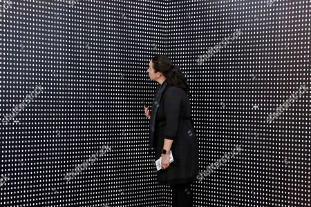 "Janine Fisher of Pittsburgh looks at an art installation called ""Prescribed to Death Memorial"" at the William Pitt Union at the University of Pittsburgh on in Pittsburgh. The installation features 22,000 carved medicine pills that represent the face of someone who fatally overdosed in 2015. A creation of the Illinois-based National Safety Council, the memorial is making it's inaugural stop in Pittsburgh through Friday. Future stops will be in Ohio, Oklahoma, Tennessee, Georgia, and New York"