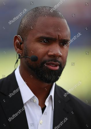 ESPN reporter and former NFL star Charles Woodson on set before the NFL Pro Bowl football game, in Orlando, Fla. The AFC won 24-23