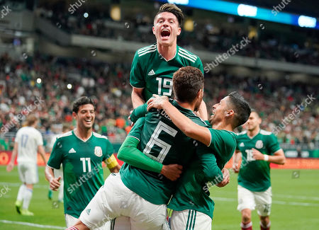 Jonathan Dos Santos, Jonathan Gonzalez, Javier Aquino. Mexico players celebrate a goal by Hugo Ayala during the second half of an international friendly soccer match against Bosnia and Herzegovina, in San Antonio. Mexico won 1-0