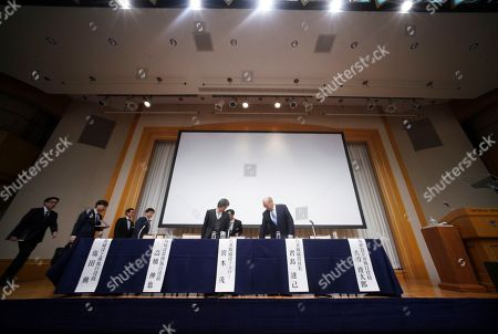 "Japanese video game maker Nintendo Co. President Tatsumi Kimishima, right, and other executive officers prepare to attend a news conference during in Tokyo . Japanese video-game company Nintendo Co. says a movie starring the plumber in the Super Mario franchise is in the works, being co-produced with Chris Meledandri, the chief executive of Illumination Entertainment, the U.S. animation studio behind the popular ""Despicable Me"" series. Nintendo's star game designer Shigeru Miyamoto told reporters Thursday the script is mostly finished and is promising a ""fun"" movie, since Meledandri shares his thinking on creative projects"