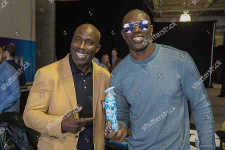 Terrell Owens poses with Terrell Davis on Radio Row while representing Febreze at Super Bowl LII, in Minneapolis, MN