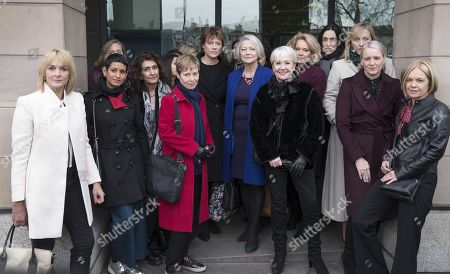 Members of the BBC Women's Group including Sonja Mclaughlan, Kasia Madera, Louise Minchin, Naga Munchetty, Mariella Frostrup, Kate Adie and Kate Silverton stand with others