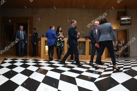 Scottish Parliament First Minister's Questions - Iain Gray, Michael Matheson, Cabinet Secretary for Justice, and Alex Neil, leave the Debating Chamber after First Minister's Questions
