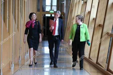 Stock Photo of Scottish Parliament First Minister's Questions - Monica Lennon, Richard Leonard, Leader of the Scottish Labour Party, Rhoda Grant make their way to the Debating Chamber.