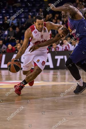 Stock Picture of Andrew Goudelock, #0 of AX Armani Exchange Olimpia Milan dribbles