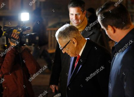 Former New York State Assembly Speaker Sheldon Silver, center, enters the subway after leaving federal court, in New York, where he appeared for a pretrial hearing to discuss his retrial. A federal appeals court in July, 2017 overturned Silver's 2015 corruption conviction. Silver had been convicted on charges that he had obtained nearly $4 million in illicit payments in return for taking a series of official actions that benefited others