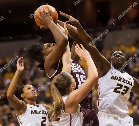 Jordan Frericks, Amber Smith, Jordan Roundtree, Teaira McCowan. Mississippi State's Teaira McCowan, top, tries to shoot as she is defended by Missouri's Amber Smith, right, Jordan Roundtree, left, and Jordan Frericks, center, during the second half of an NCAA college basketball game, in Columbia, Mo. Mississippi State won the game 57-53