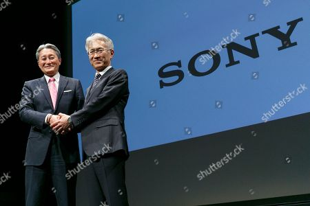 (L to R) Kazuo Hirai, Sony's Director, Representative Corporate Executive Officer, President and Chief Executive Officer and Kenichiro Yoshida, Sony's Director, Representative Corporate Executive Officer, Executive Deputy President and Chief Financial Officer shake hands during a news conference at company's headquarters