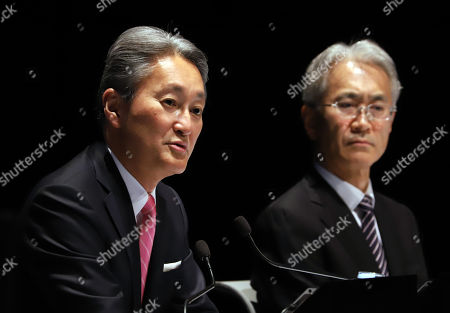 Japan's electronics giant Sony president Kazuo Hirai (L) speaks as he names the new president to the company's CFO Kenichiro Yoshida at Sony's headquarters in Tokyo