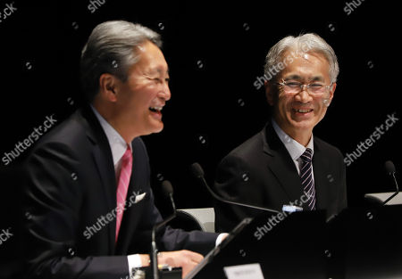 Japan's electronics giant Sony CFO Kenichiro Yoshida (R) shares a laugh with president Kazuo Hirai (L) as Yoshida is named the new president at Sony's headquarters in Tokyo