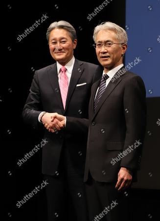 Japan's electronics giant Sony president Kazuo Hirai (L) shakes hands with the company's CFO Kenichiro Yoshida as Hirai names Yoshida to his successor at Sony's headquarters in Tokyo