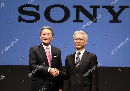 Japan's electronics giant Sony president Kazuo Hirai (L) shakes hands with the company's CFO Kenichiro Yoshida as Hirai names Yoshida to his successor at Sony's headquarters in Toky