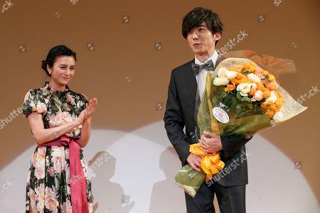 Stock Photo of (L to R) Japanese actress Ko Shibasaki and actor Issei Takahashi