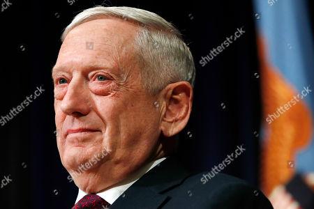 Stock Image of Defense Secretary James Mattis attends a portrait unveiling ceremony for former Secretary Ash Carter, at the Pentagon