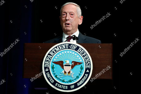 Defense Secretary James Mattis speaks during a portrait unveiling ceremony for former Defense Secretary Ash Carter, at the Pentagon